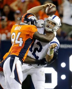 Indianapolis Colts quarterback Andrew Luck (12) is sacked by Denver Broncos defensive end DeMarcus Ware (94) during the first half of an NFL football game, Sunday, Sept. 7, 2014, in Denver. (AP Photo/Jack Dempsey)