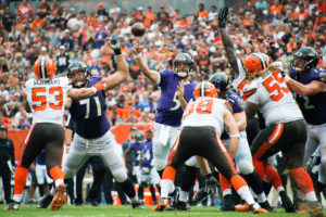 CLEVELAND, OH - SEPTEMBER 18: Quarterback Joe Flacco #5 of the Baltimore Ravens throws a touchdown pass to wide receiver Mike Wallace #17 during the second quarter against the Cleveland Browns at FirstEnergy Stadium on September 18, 2016 in Cleveland, Ohio. (Photo by Jason Miller/Getty Images)