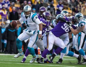 Nov 30, 2014; Minneapolis, MN, USA; Carolina Panthers quarterback Cam Newton (1) escapes the pocket during the first quarter against the Minnesota Vikings at TCF Bank Stadium. Mandatory Credit: Brace Hemmelgarn-USA TODAY Sports