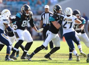 Jacksonville Jaguars tight end Nic Jacobs (85) and linebacker Jordan Tripp (58) block on special teams punt against the San Diego Chargers in an NFL Game Sunday, November 29, 2015, in Jacksonville, Fl. (Rick Wilson/Jacksonville Jaguars)